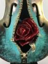Katarzyna Bułka Matłacz, - wys. 26 cm, szer. 16 cm - rzeźba wykonana w brązie, pokryta srebrem, kula pokryta złotem, podstawa czarny mahoń