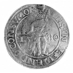 półtalar 1580, Aw: Dziki człowiek z kagankiem, w polu d...