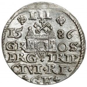 Stefan Batory, Trojak Ryga 1586 - duża głowa, lilijki