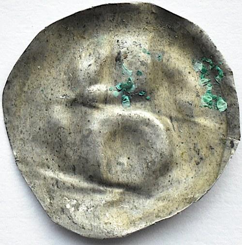 Brakteat, głowa pod łukiem, II połowa XII wieku