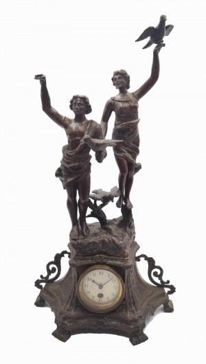 Zegar z dwoma figurami dziewczyn z ptakami