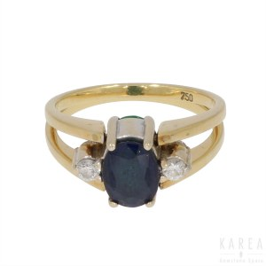 An emerald and sapphire two sided swivel ring, contemporary