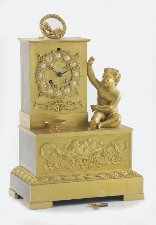 Zegar kominkowy z figurą dziecka