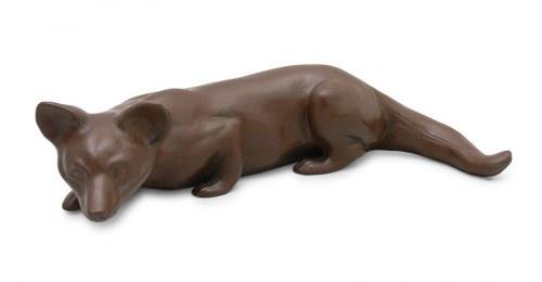 Figurka polującego lisa