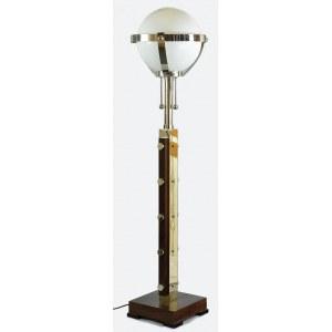 Lampa elektryczna, podłogowa, w typie art-dec, drewno, metal niklowany, szkło mleczne; wys. 186 cm; podstawa 35,8 x 35,5 cm.